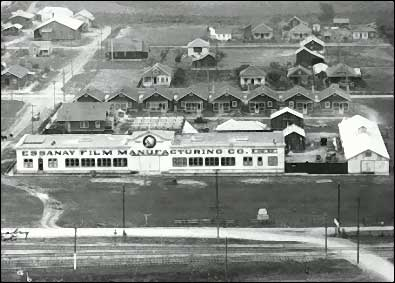 """Essanay's Niles facility: The main building measured 200-feet by 50-feet with a glass-roofed interior studio immediately behind it. The smaller white building on the right was the studio's stable (you can't make horse operas without horses) which also housed a blacksmith shop. The cottages across the back of the facility housed actors and technicians. In the foreground you can see the train tracks that brought """"Broncho Billy"""" and his crew to Niles. Photo courtesy of the Niles Essanay Silent Film Museum."""