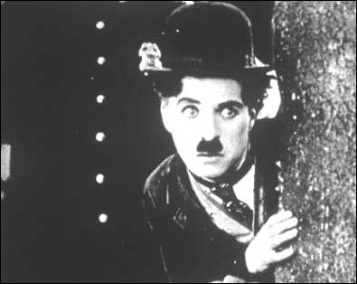 Charles Chaplin as his signature character, The Little Tramp. During a career that spanned about eight decades, Chaplin made a total of 82 films, at least ten of which featured him in the role of the beloved tramp. Photo believed to be in the public domain.