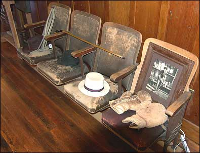 Many citizens of Niles sat in these seats to watch motion pictures back in 1913. They are the only original furnishings left from the Edison Theater. The items displayed on the seats are props and artifacts representative of those used by Charlie Chaplin, Broncho Billy and other Essanay players. Photo: HPO collection.