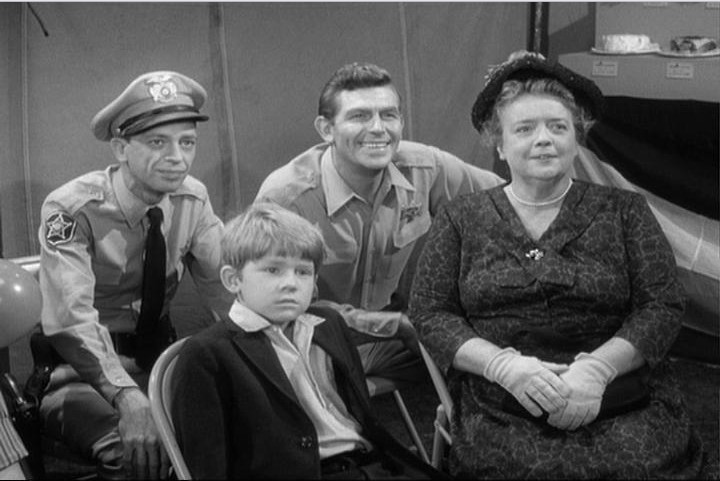 Deputy Barney Fife (Don Knotts), Opie Taylor (Ron Howard), Sheriff Andy Taylor (Andy Griffith), and Aunt Bee (Frances Bavier)