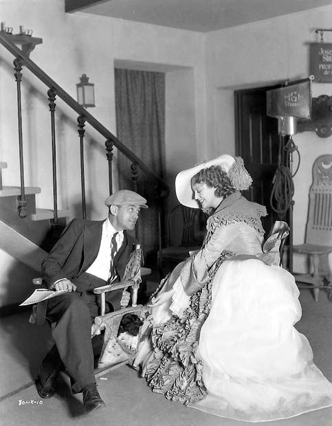 Director W.S. Van Dyke and Jeanette MacDonald between takes of Naughty Marietta in 1935