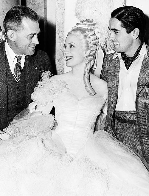 Director Woody Van Dyke, Norma Shearer and Tyrone Power on set of Marie Antoinette (1938)