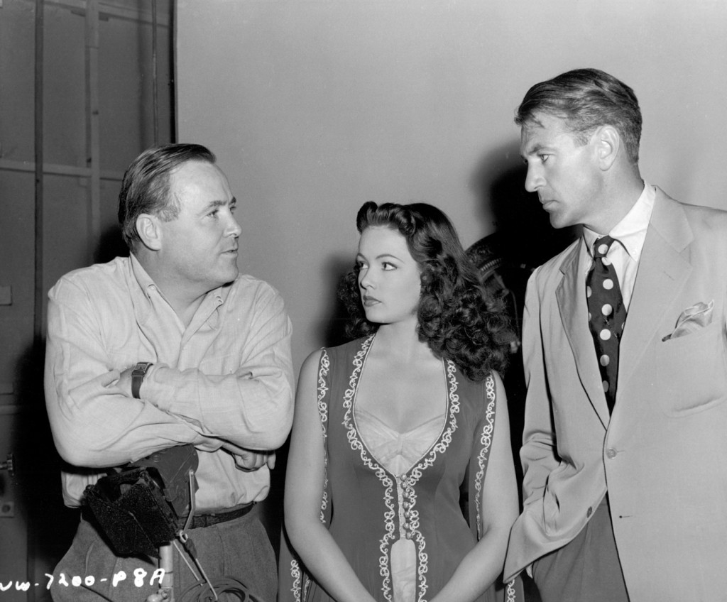 Henry Hathaway with Gene Tierney and visitor Gary Cooper on the set of Sundown