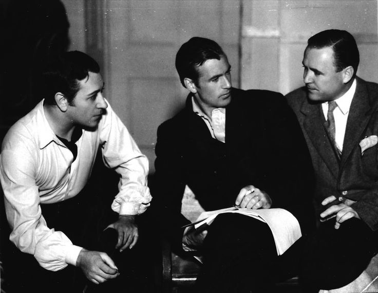 George Raft, Gary Cooper, and director Henry Hathaway on set of Souls at Sea, 1937
