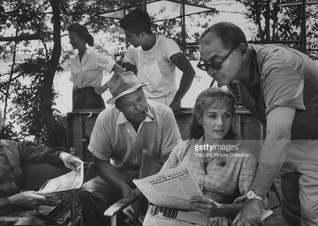 Henry Hathaway with actress Debbie Reynolds on the set of How the West Was Won during break in shooting