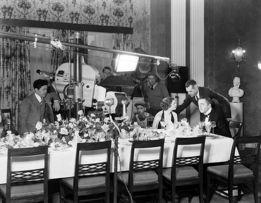 "James Wong Howe, Myrna Loy, W.S. Van Dyke, William Powell during filming of ""The Thin Man"" (1934)"