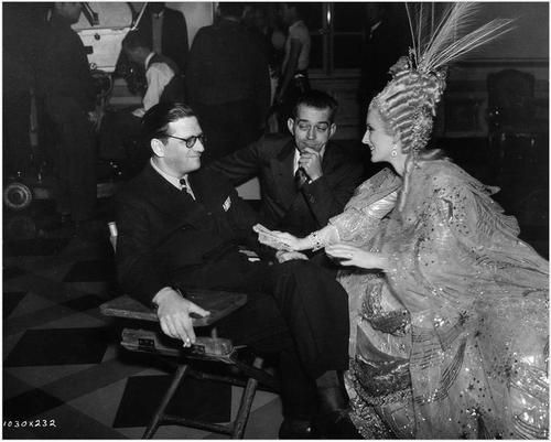 Producer Hunt Stromberg, Director W. S. van Dyke and Norma Shearer on the set of Marie Antoinette (1938)