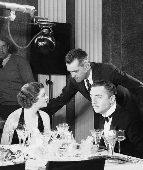 W.S. Van Dyke directs Myrna Loy and William Powell on the set of The Thin Man (1934)