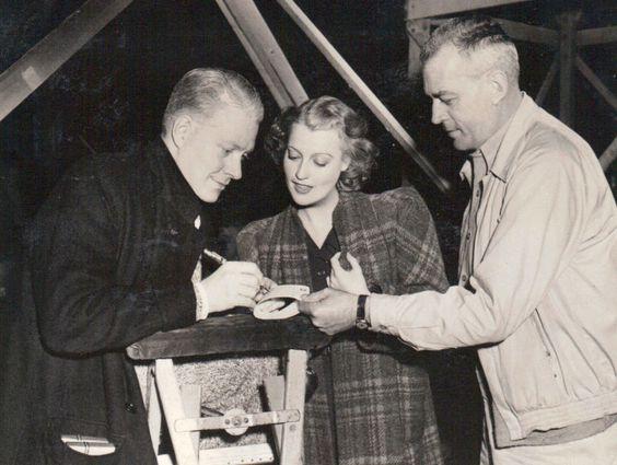 W.S. Van Dyke, Nelson Eddy and Jeanette MacDonald.