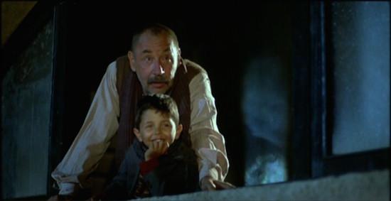 Philippe Noiret and Salvatore Cascio in Cinema Paradiso