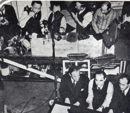Dave Fleischer, composer Sammy Timberg, and Lou Fleischer, head of Fleischer Studios Music. Dept., at the piano