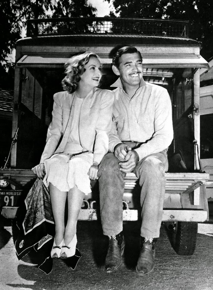 clark gable and carol lombard sitting on truck