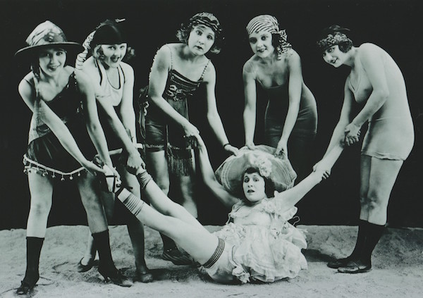 The Mack Sennett Bathing Girls pick on Virginia Fox, with Thelma Hill pulling her leg on the right.