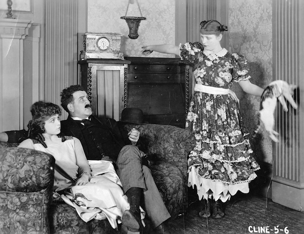 Ethel Teare threatens Tom Kennedy and Lois Scott with a limp cat in Mary's Little Lobster (1920).