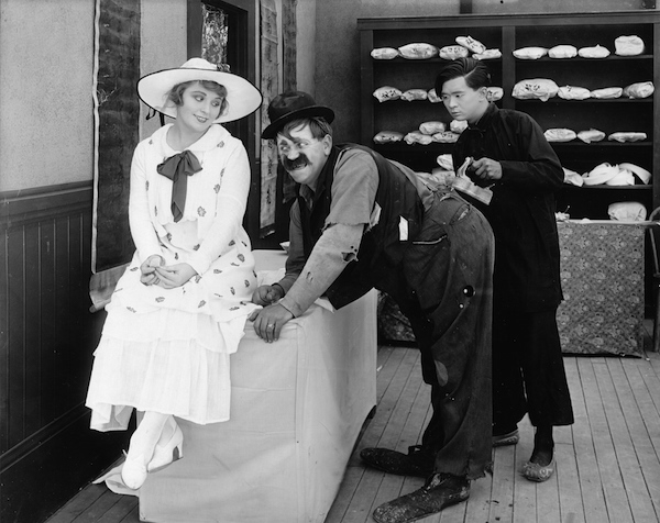 Ethel Teare seems interested in tramp Lloyd Hamilton in THE WINNING WASH (1915).