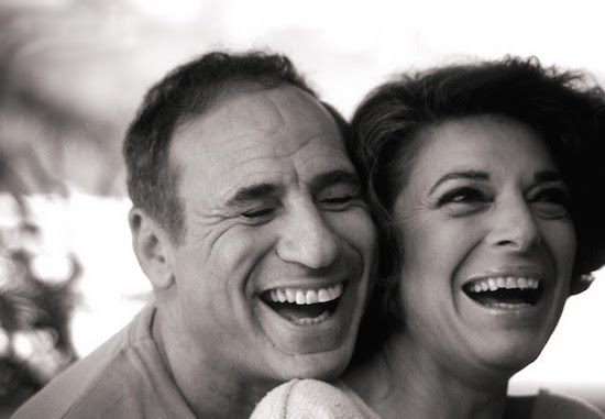 Anne Bancroft and Mel Brooks laughing