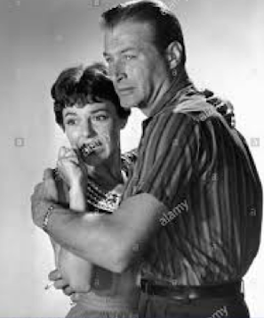Anned Bancroft and Lex Barker in The Girl in the Black Stockings