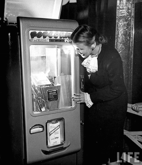 Vintage coin operated popcorn vending machine, 1947