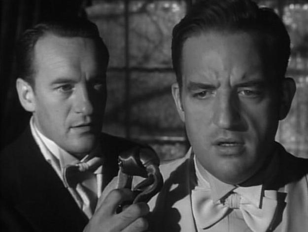 Dr. Middleton (George Sanders) informs Harvey Bone (Laird Cregar) of the terrible secret that he's kept hidden away.