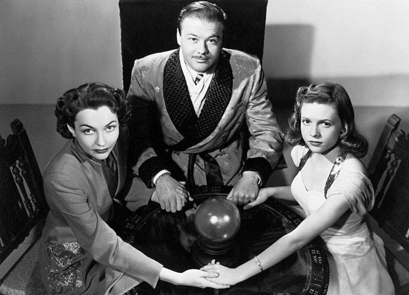 Left to Right: Christine Faber (Lynn Bari), Alexis (Turhan Bey), and Janet Burke (Cathy O'Donnell) attempt to contact the dead.