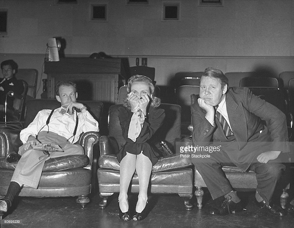 Dir. Garson Kanin (L) w. anxious actors Carole Lombard & Charles Laughton as they view a screening of their movie They Knew What They Wanted at RKO Studios.