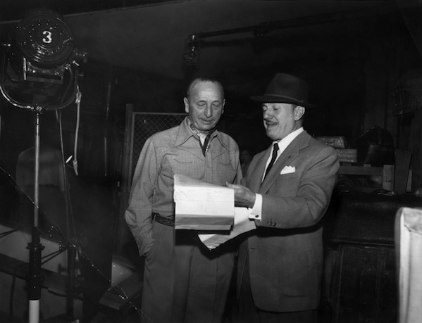 Jack L. Warner and Michael Curtiz looking at Yankee Doodle Dandy script