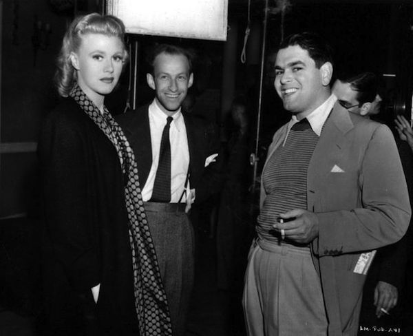 Ginger Rogers, Garson Kanin (director) and Pandro S Berman on the set of Bachelor Mother