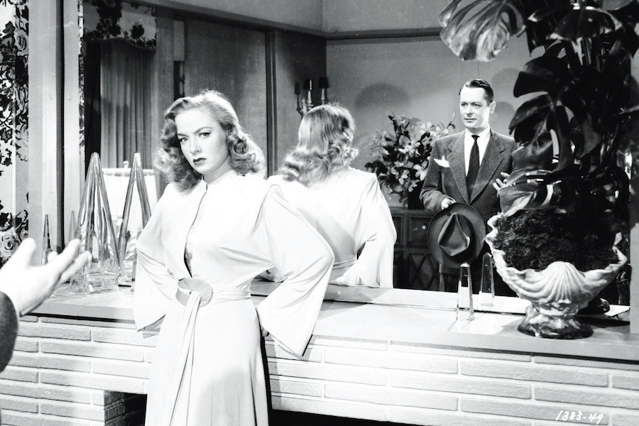 Adrienne Fromsett (Audrey Totter) recoils from Philip Marlowe (Robert Montgomery).