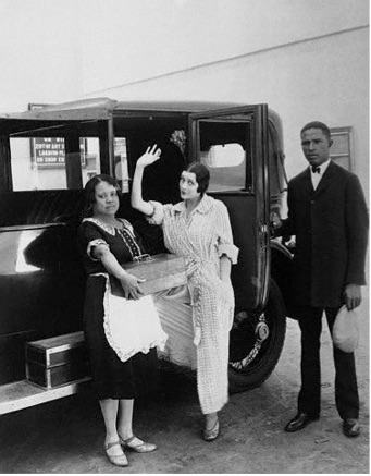 Barbara La Marr pictured with her maid and chauffeur, often arrived at the studio in her bathrobe throughout filming of The Girl from Montmartre (released in 1926).