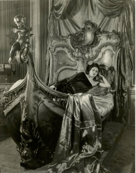 Barbara La Marr poses on a gilded bed owned by singer, dancer, and actress Gaby Deslys.