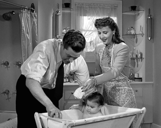 Christmas in Connecticut Dennis Morgan and Barbara Stanwyck bathing the baby