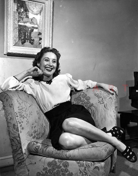 betty garrett sitting on Couch