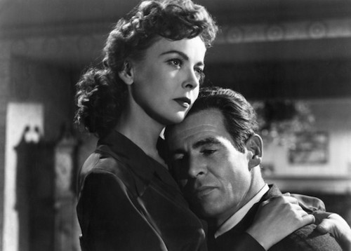 Robert Ryan with Ida Lupino in On Dangerous Ground