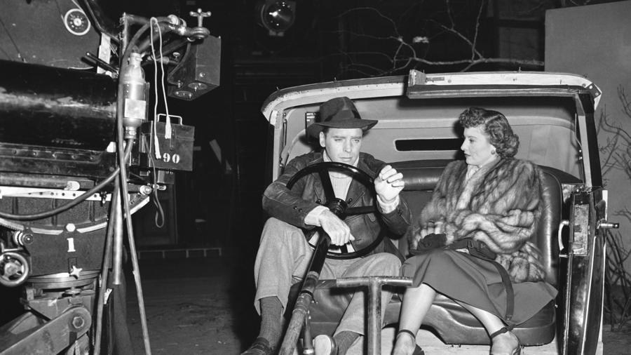 Lancaster and Stanwyck behind the scenes.