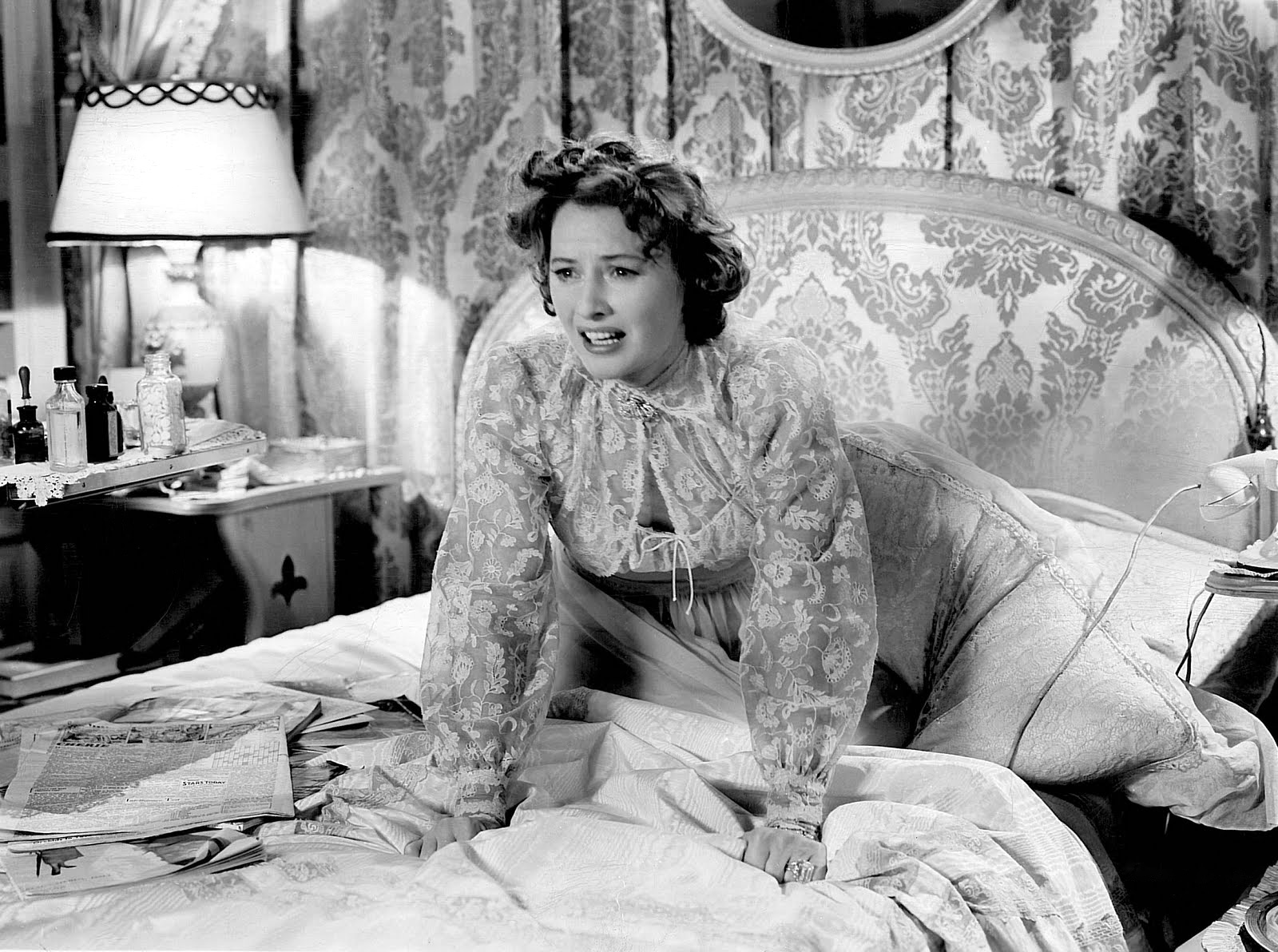 Leona (Stanwyck) desperately clings to her sanity.