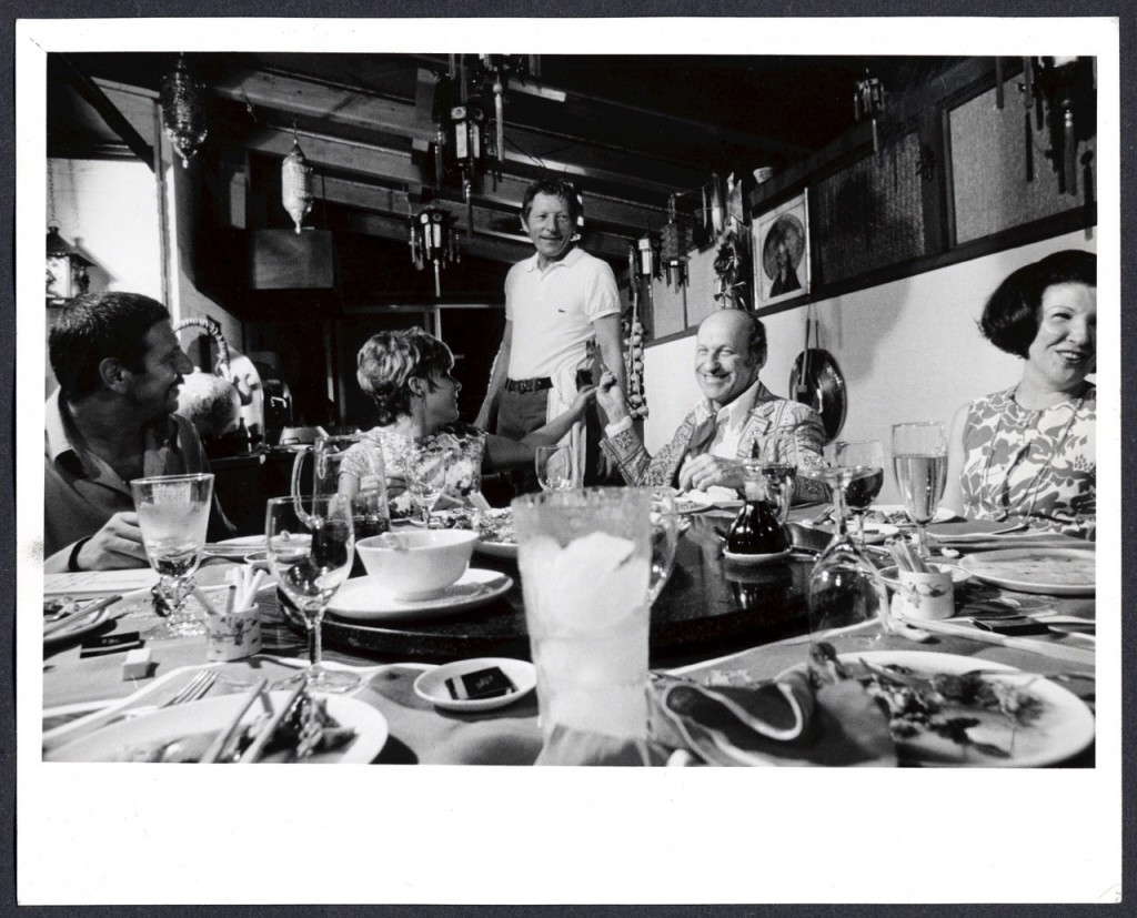 Danny Kaye serves guests in his Chinese Kitchen.