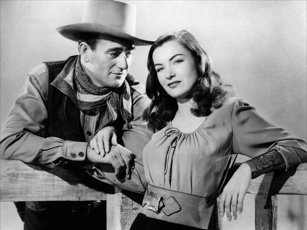 John Wayne and Ella Raines in Tall in the Saddle (1944)