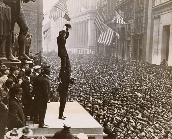 Charlie Chaplin stands on Douglas Fairbanks shoulders at Liberty Loan rally
