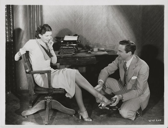 Man Wanted (1932) Kay Francis as Lois Ames and David Manners as Tom Sherman putting on Shoe