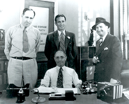 Circa 1935 shot of the main Brooklyn Vitaphone studios directors posing  in studio head Sam Sax's office. Standing l to r: Joseph Henabery, Lloyd French and Roy Mack. Sam Sax  seated