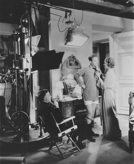 Clarence Brown directs William Gargan and Myrna Loy in Night Flight