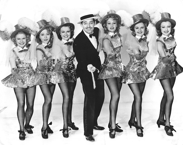 Clark Gable as Harry with his dance troupe in Idiot's Delight