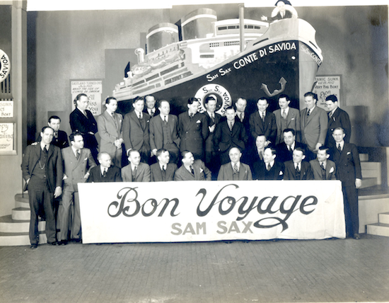 "A gathering in 1939 at the closing of the Brooklyn Vitaphone studios. All short subject production was  shifted to Hollywood.  Henabery is standing at far left and Sax is sitting behind the ""O"" in ""Voyage""."