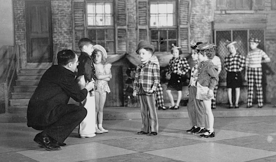 "Candid shots of Henabery directing a 1938 Vitaphone ""kiddie "" short, TOYLAND CASINO.  He directed  one entry each year from 19835 to 1939, drawing child performers from Manhattan area talent schools."