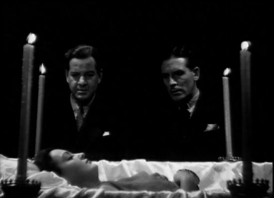 Nora Moran - John (Alan Dinehart) and Dick (Paul Cavanagh) discussing details of Nora's (Zita Johann) execution PHOTO 3