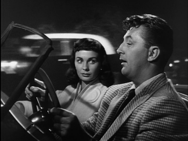 Diane (Simmons) and Frank (Mitchum)