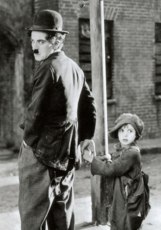 Charlie Chaplin and Jackie Coogan on set of The Kid (1921)