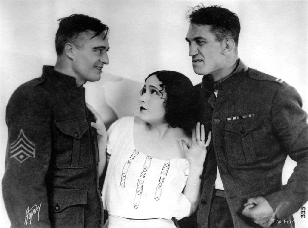 Dolores del Río alongside Edmund Lowe and Victor McLaglen in a publicity photo for her most acclaimed silent film, What Price Glory? (1926)