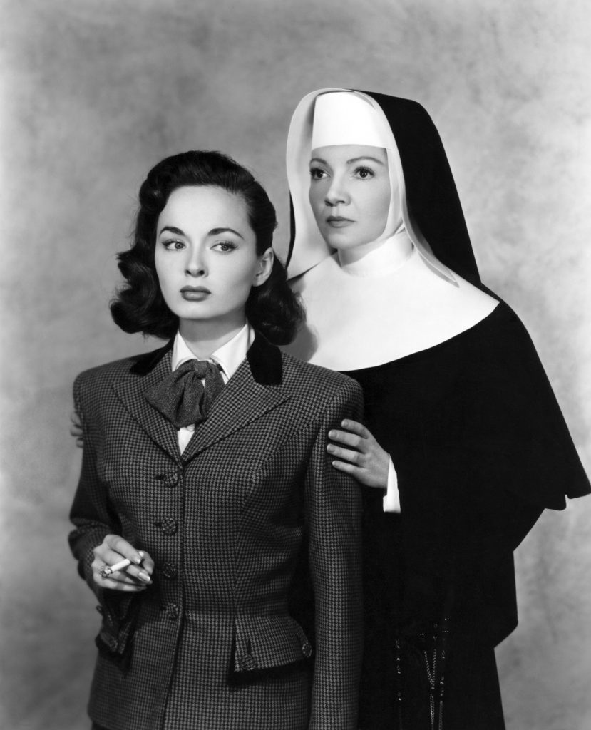 Colbert shown with Ann Blyth in a publicity photo for Thunder on the Hill (1951)