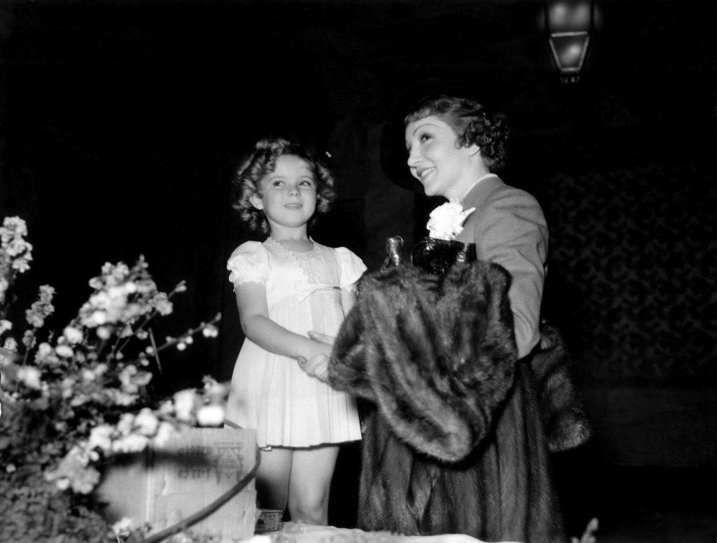 Shirley Temple presenting Claudette Colbert with her Best Acress Academy Award for It Happened One Night on February 27, 1935.